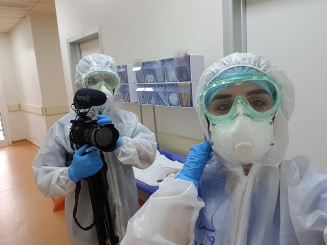 Freelance photographer and videographer Zmnako Ismael (left) is seen covering the COVID-19 pandemic. (Zmnako Ismael)